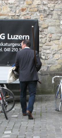 176 Man in suit with halberd